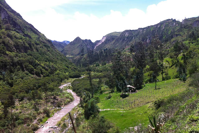 Quilotoa loop, a green valley with a river