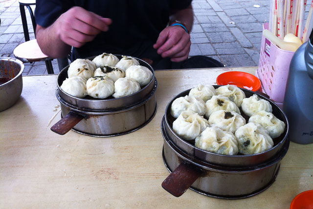 two steamers with dumplings on table Sampling some Chinese dumplings.