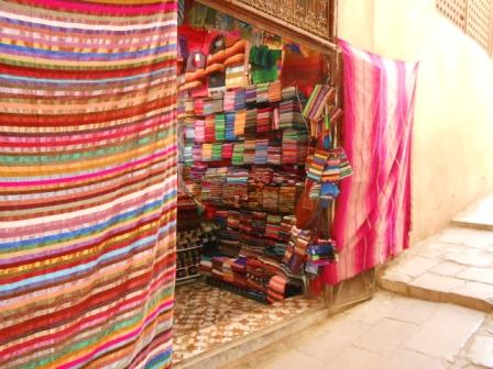 Hand loomed cactus silk rfabrics eady for sale in the Fez souq
