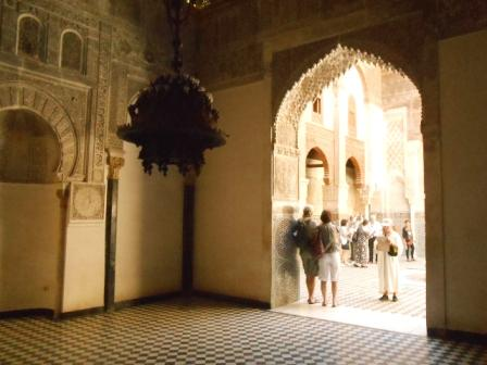 Toursists looking through an historical Madrassa in Moroccan City Fez