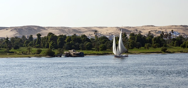 The Nile in Aswan with a felucca sailing by Egyptian Nile cruise