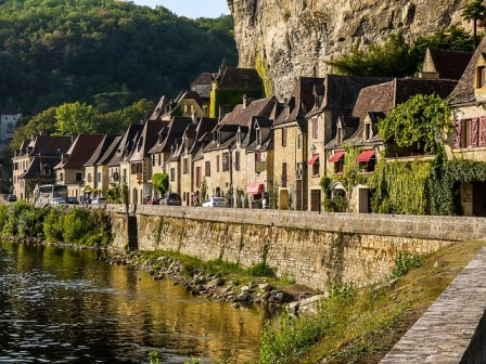 A village in the Perigord Noir region built under a limestone overhang on the edge of the Dordogne river