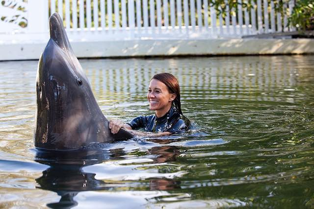 Dolphin plays with a woman in Florida keys